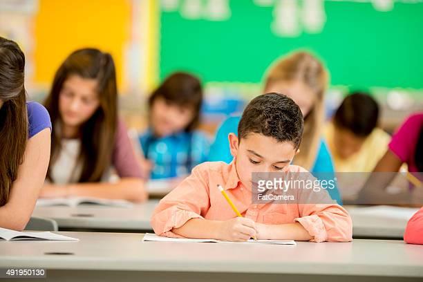 Boy in Elementary Class Taking a Test