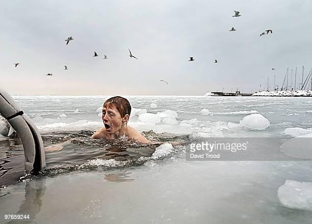 Boy in frozen sea.