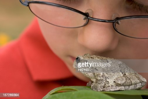 Boy In Glasses Looking at A Frog