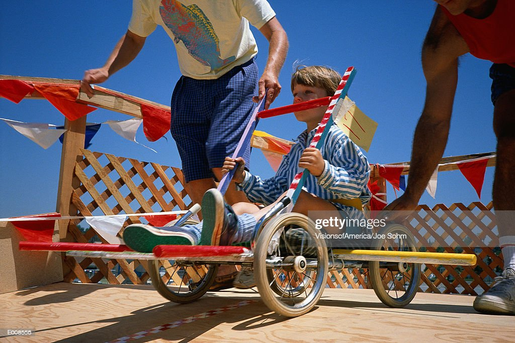 Boy in go-cart at starting gate : Stock Photo