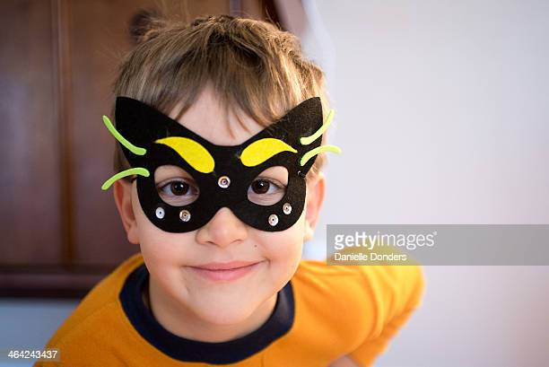 Boy in handmade black mask