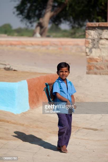 Boy in Hindu Brahman high caste village of Dhudaly heading for school in Rajasthan Northern India