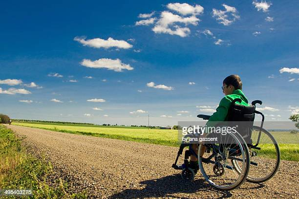 Boy in his wheelchair