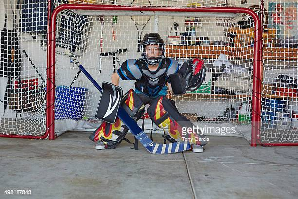 Boy in hockey goal wearing protective sportswear