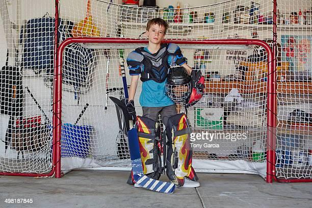 Boy in hockey goal wearing protective sportswear