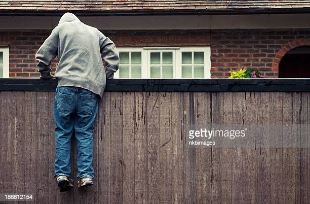 Boy in hoodie trespassing on private residential property