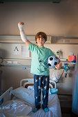 boy in hospital burn unit with soccer ball