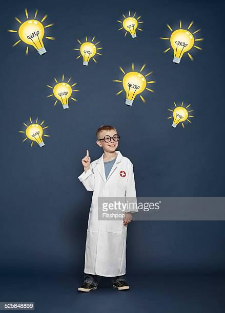 Boy in lab coat with cartoon lightbulbs