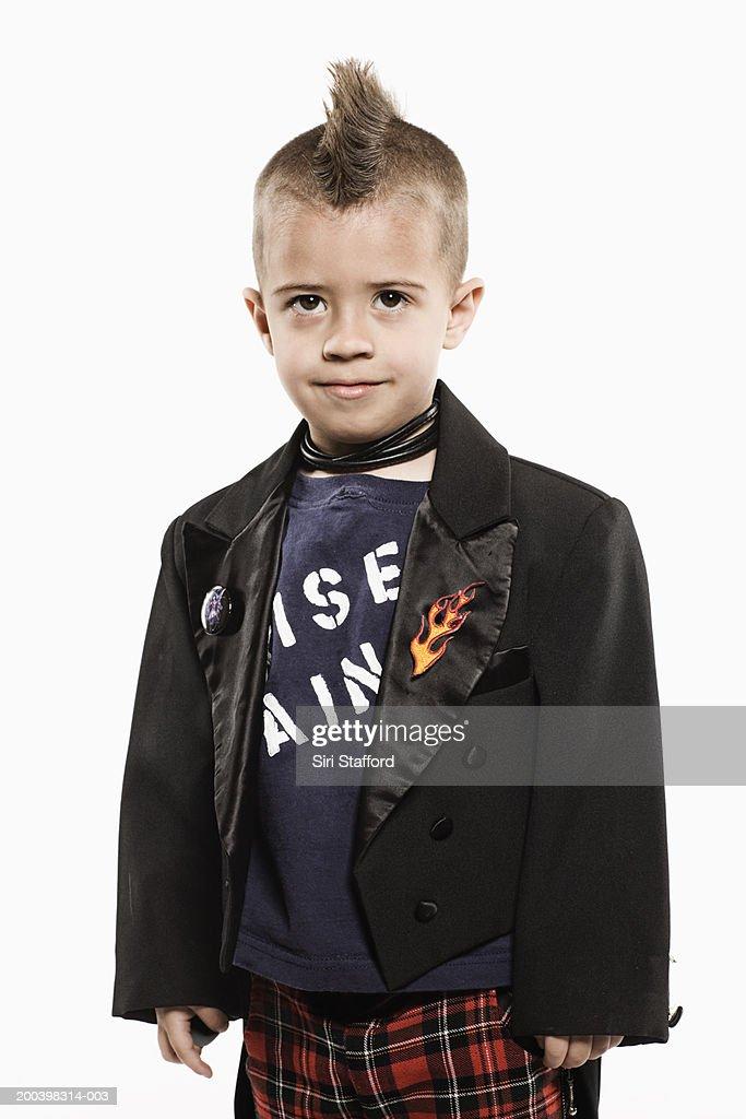 Boy (4-6) in mohawk wearing punk outfit