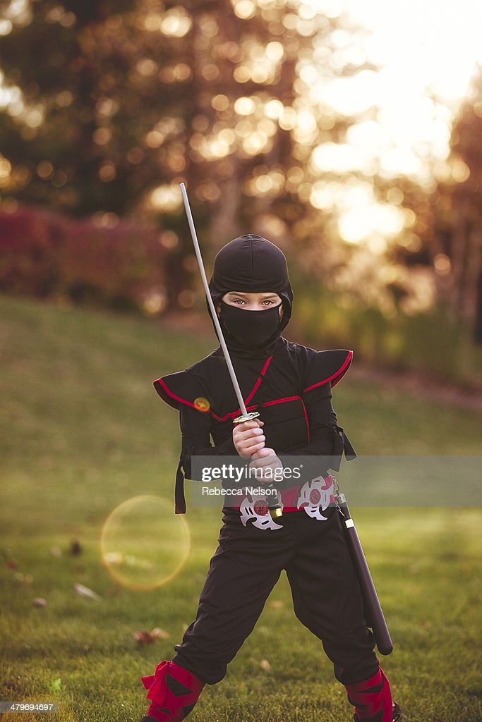Boy in ninja costume : Stock Photo