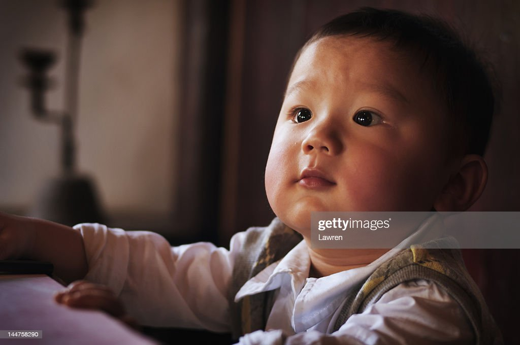 Boy in old Chinese room : Stock Photo