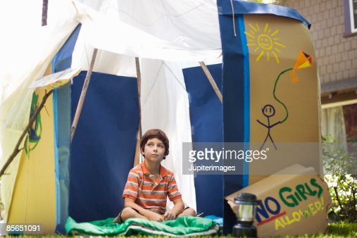 Boy in outdoor playhouse
