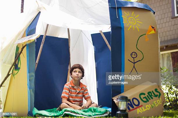 Boy in outdoor playhouse