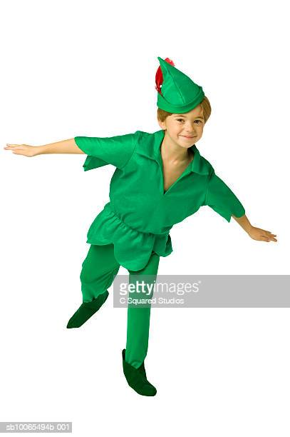 Boy (4-5) in Peter Pan costume standing on one leg pretending to fly, portrait