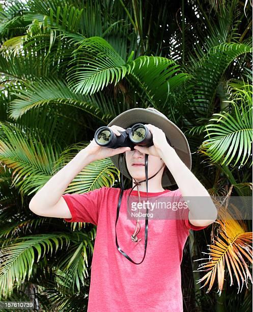 Boy in safari hat with binoculars. Young explorer, adventurer.