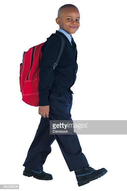 Boy in school uniform with red backpack