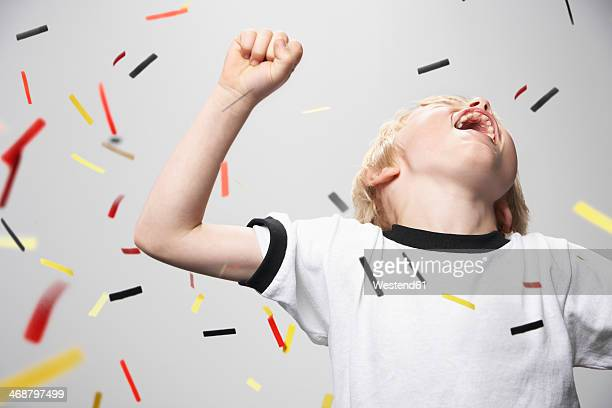 Boy in soccer jersey cheering