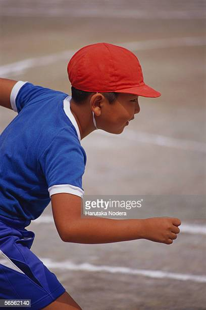 Boy in starting position at school sports day
