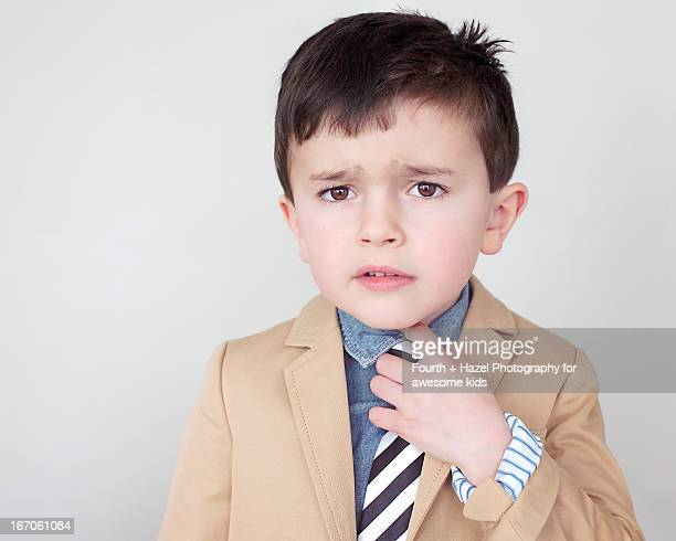 Boy in suit jacket and tie