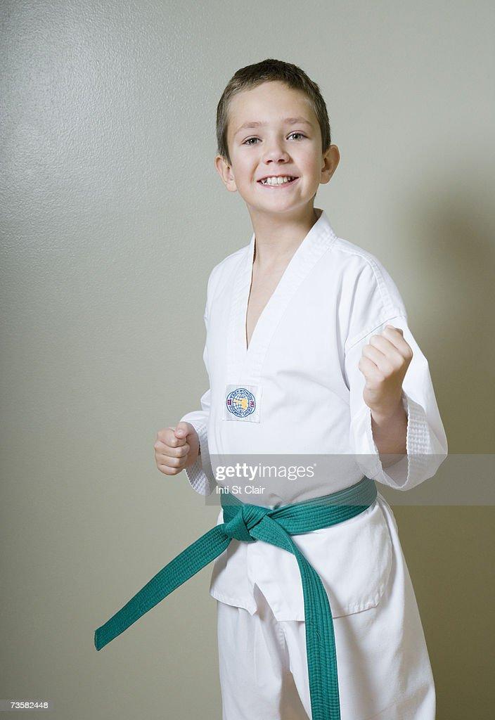 Boy (8-10) in Taekwondo uniform : Stock Photo