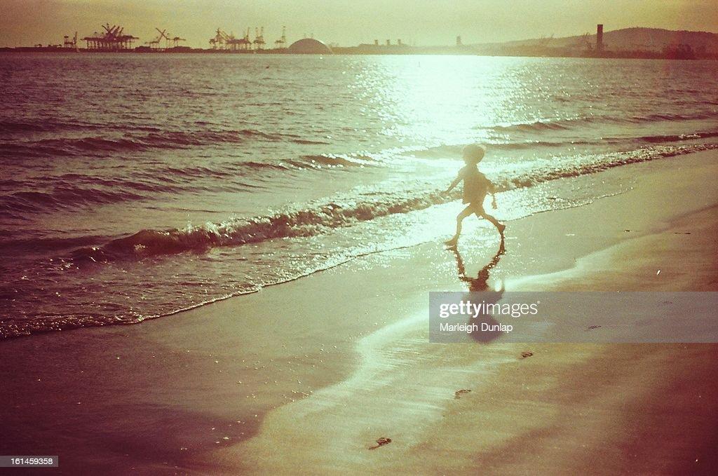 Boy in the sun : Stock Photo
