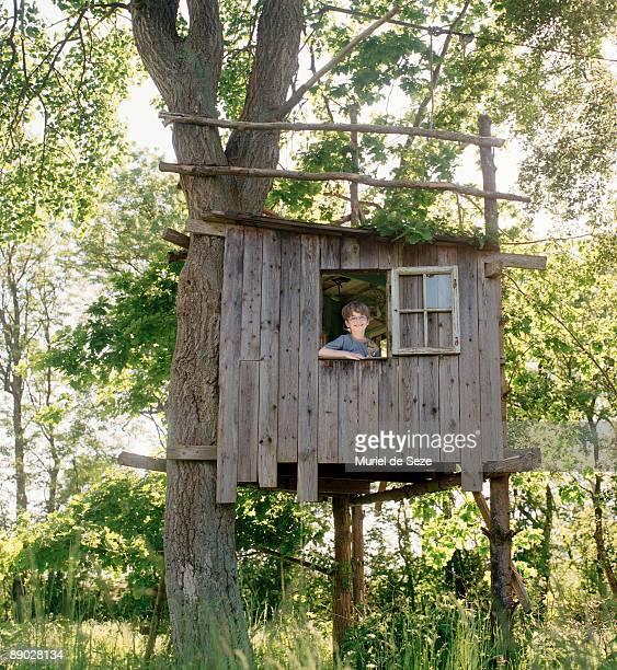 boy in tree house