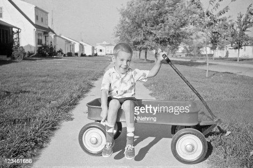 boy in wagon 1957, retro