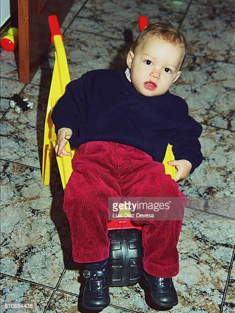 boy in wheel barrow at roon