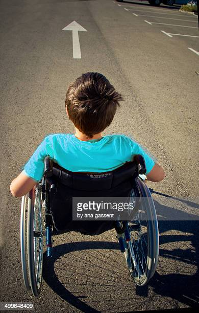 boy in wheelchair goes ahead