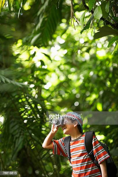 Boy in Wilderness Area Taking Picture