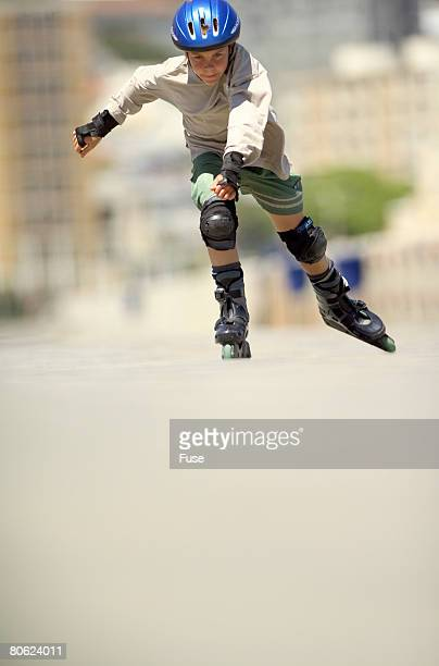 Boy inline skating
