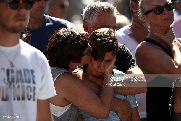 A boy is comforted as people gather and lay tributes on the Promenade des Anglais on July 16 2016 in Nice France Five people believed to be linked to...