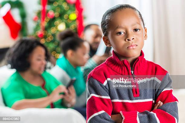Boy is concerned with family's use of technology at Christmastime