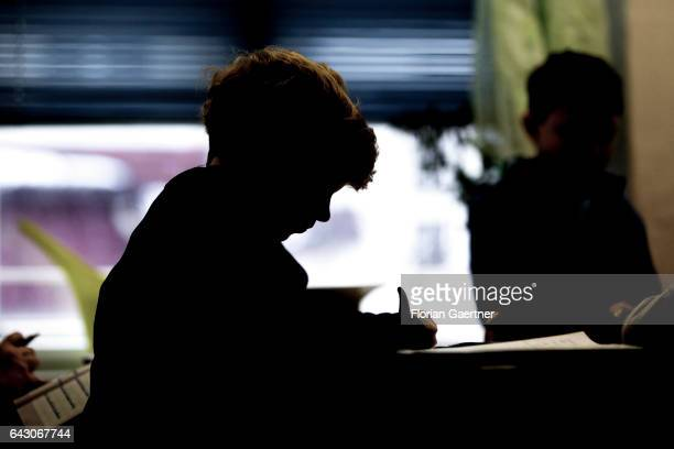 A boy is learning during class Feature at a school in Goerlitz on February 03 2017 in Goerlitz Germany