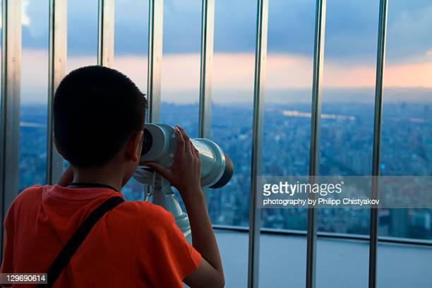 Boy is looking at city view