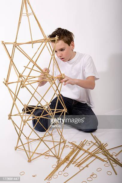 Boy is making a construction for his technique activities