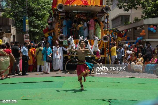 Boy is performing dance in front of the chariot of lord jagannath on occasion of rathyatra in Kolkata India on 2562017Rath Yatra or the cart festival...