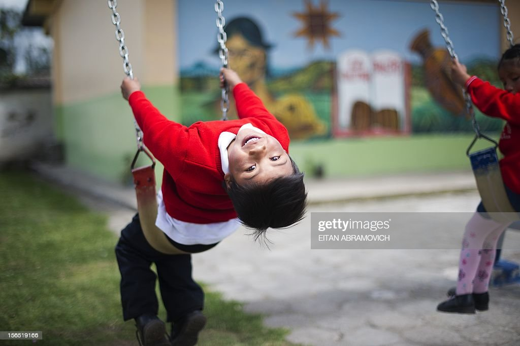 A boy is pictured in the playground of a rural school at La Palizada in Tulcan, Carchi province, in Ecuador close to the Colombian border on November 7, 2012. AFP PHOTO/Eitan Abramovich