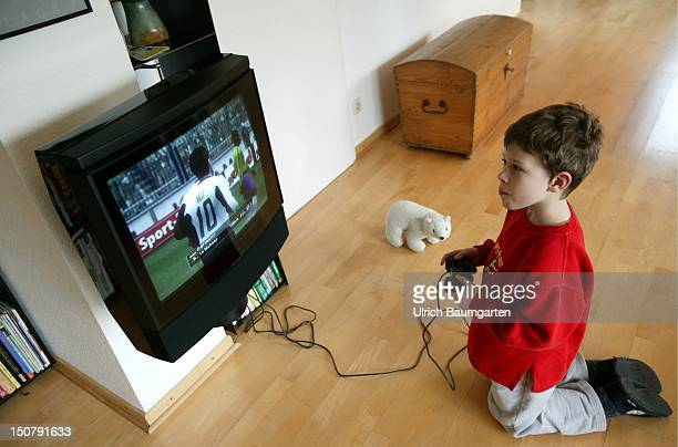 Boy is playing with ' Playstation '