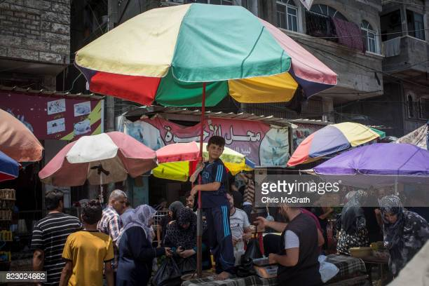 A boy is seen at his families stall sells at a market on July 21 2017 in Gaza City Gaza For the past ten years Gaza residents have lived with...