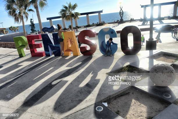 A boy is seen at the Malecon in Puerto Penasco Sonora state Mexico on March 26 2017 / AFP PHOTO / PEDRO PARDO