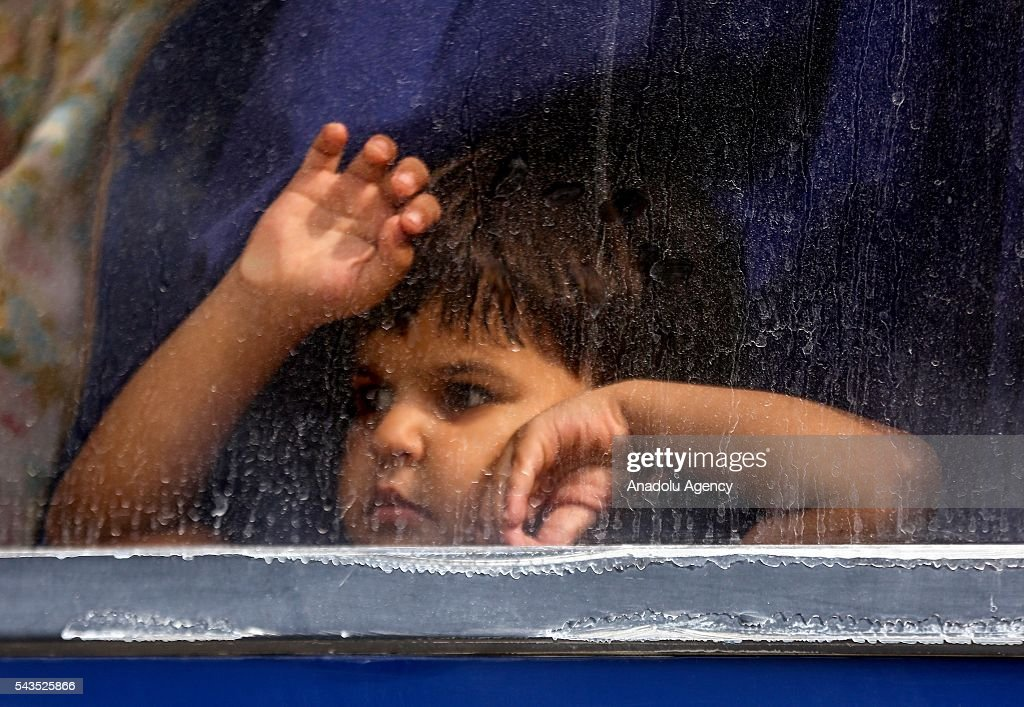 A boy is seen in a bus at the Rafah border gate, which is Gaza's only access to the outside world, after Egyptian authorities temporarily reopened it both directions in Gaza Strip, Gaza on June 29, 2016. Students, patients, people with residence permit and passport owners are allowed to cross to border.