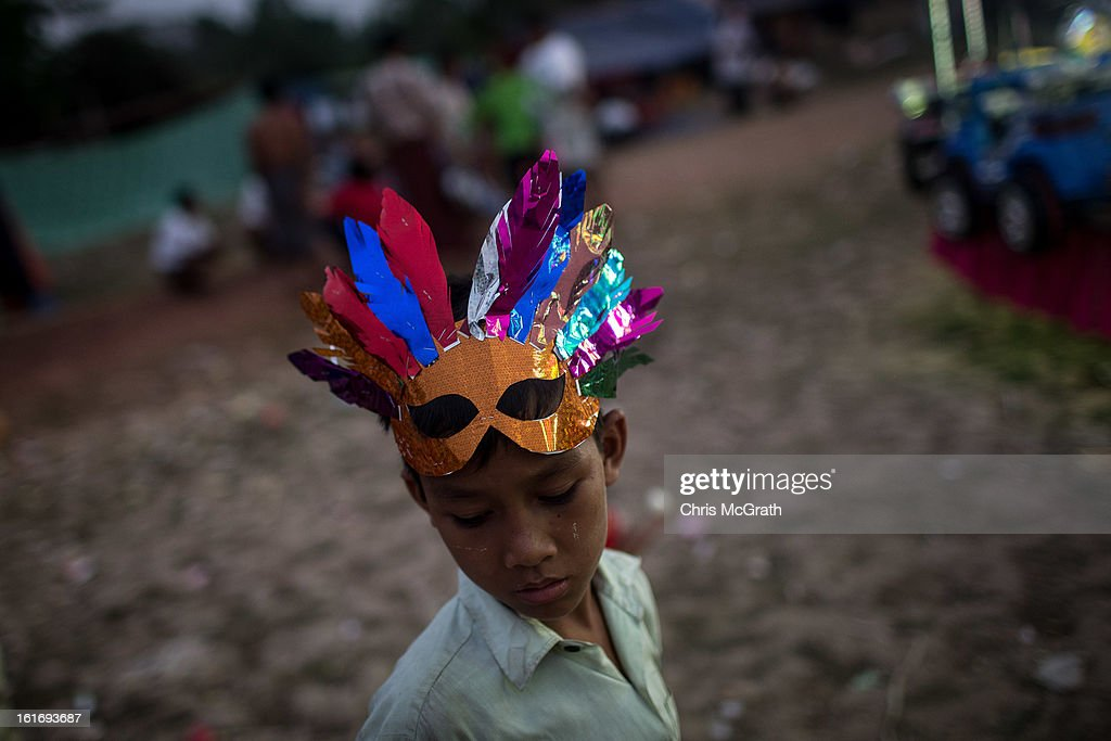 A boy is seen wearing a mask at a rural carnival in South Dagon Township on February 14, 2013 in Yangon, Burma. Myanmar is going through rapid political and economic reforms initiated by the countries first civilian president Thein Sein after years of military junta rule.