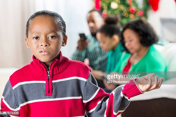Boy is upset with family for using technology at Christmastime