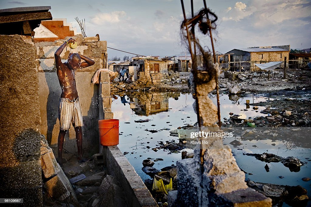 A boy is washing himself in an area completely destroyed by the hurricanes. During the first eight months of 2008 Haiti got hit by two tropical storms and two hurricanes leaving more than a million people homeless.