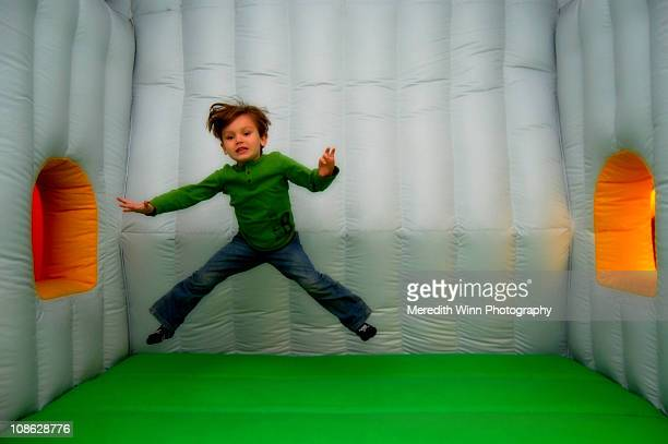 Boy jumping in an inflatable bounce house