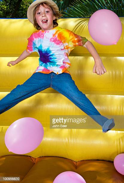 Boy jumping in inflatable