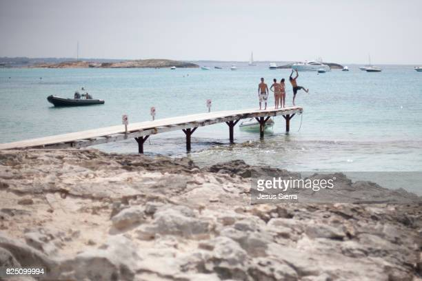 Boy jumping in Ses Illetes, Formentera