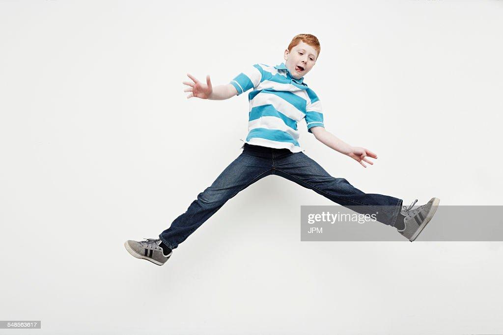 Boy jumping into midair