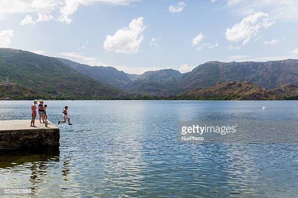 A boy jumping into the water in Sanabrias lake the largest one of glacial origin in the Iberian Peninsula in Zamora province Spain on August 30 2015